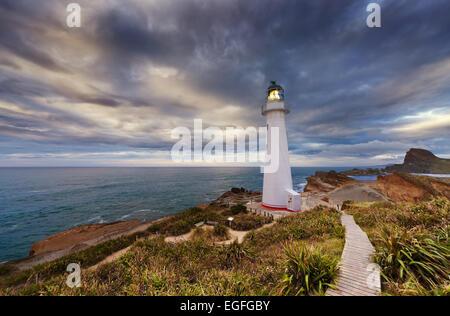 Castle Point Lighthouse at sunrise, Wairarapa New Zealand - Stock Photo
