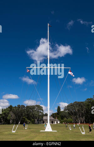 The flagstaff at Waitangi treaty grounds flying the 3 official New Zealand flags. - Stock Photo