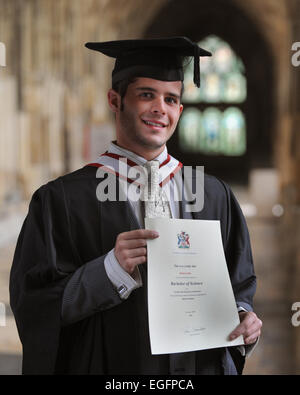 Graduate Student with certificate - Stock Photo