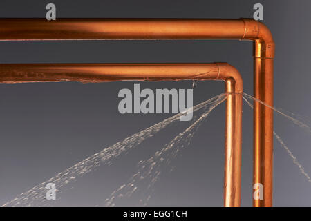 Leaking Burst Pipes - Stock Photo
