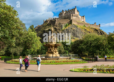 Edinburgh Castle and the Ross Fountain as seen from Princes Street Gardens - Stock Photo