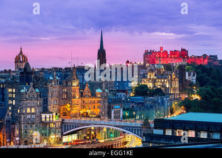 The Edinburgh skyline with the Edinburgh castle in the background. Photographed from Calton Hill just after sunset. - Stock Photo