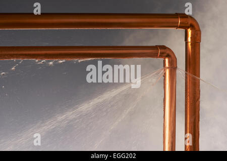Leaking Burst Pipes - Stock Photo