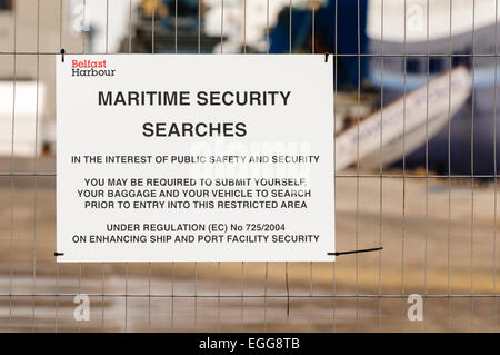 Security sign at the Port of Belfast warning about security searches - Stock Photo