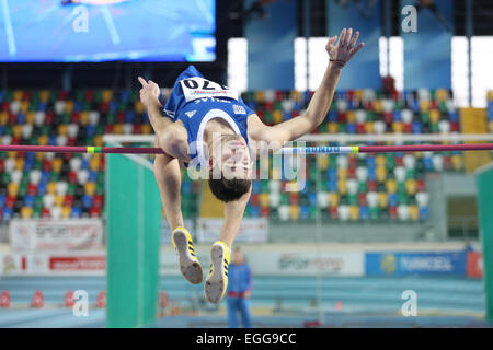 ISTANBUL, TURKEY - FEBRUARY 21, 2015: Greek athlete Georgios Tessaromatis high jump during Balkan Athletics Indoor - Stock Photo