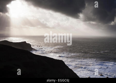 Sun breaking through clouds over sea, Morwenstow, Cornwall, England, UK - Stock Photo