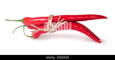 Three red chili peppers tied with a rope reversed isolated on white background - Stock Photo
