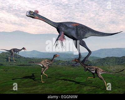 Gigantoraptor surrounded by small Mononykus dinosaurs. - Stock Photo