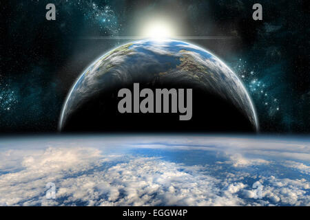 The sun rises over one of a pair of twin planets. Both planets are covered in water and clouds. - Stock Photo