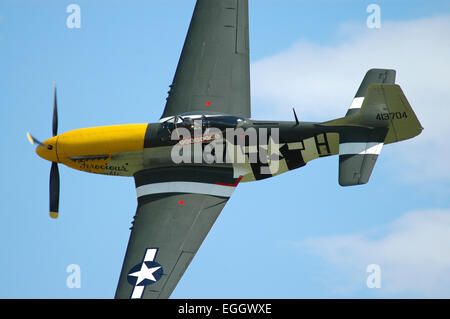 North American P-51D Mustang, nicknamed Ferocious Frankie, in United States Army Air Corps colors during a low pass - Stock Photo