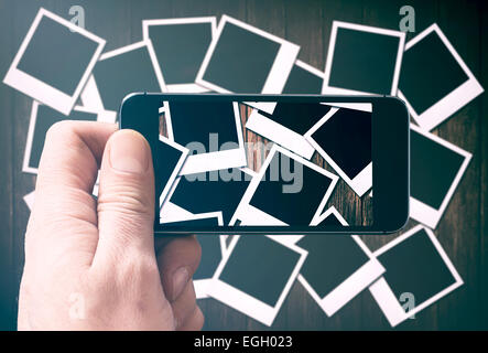 Large group of blank old camera films photographing by phone camera - Stock Photo