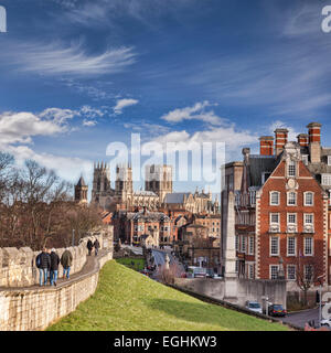 The city of York, North Yorkshire, England, a view along the city wall towards York Minster, tourists walking along - Stock Photo