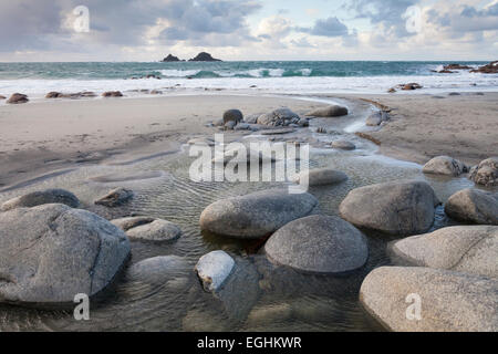 Rocks in freshwater stream flowing to sea, 'Porth Nanven' beach and the Brisons, 'Cot Valley', Cornwall, England, - Stock Photo