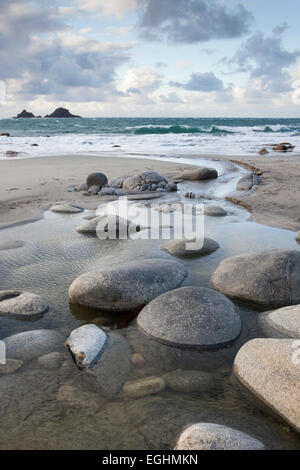 Rocks in freshwater stream flowing to sea, 'Porth Nanven' beach, 'Cot Valley', Cornwall, England, UK - Stock Photo
