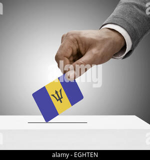 Black male holding flag. Voting concept - Barbados - Stock Photo
