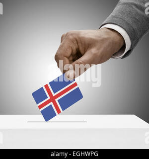 Black male holding flag. Voting concept - Iceland - Stock Photo