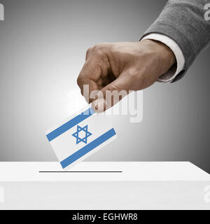 Black male holding flag. Voting concept - Israel - Stock Photo