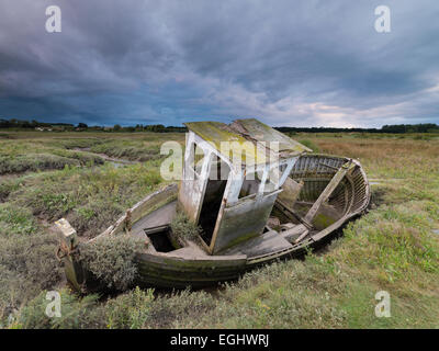 An old boat on the Saltmarshes at Thornham, Norfolk, England. - Stock Photo