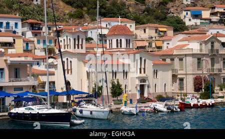 Quayside and church on Island of Poros, Argolida, Peloponnese, Greece - Stock Photo