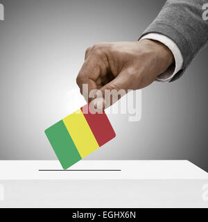 Black male holding flag. Voting concept - Mali - Stock Photo