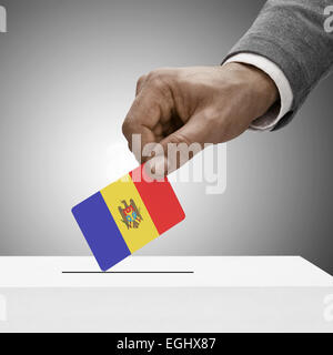 Black male holding flag. Voting concept - Moldova - Stock Photo