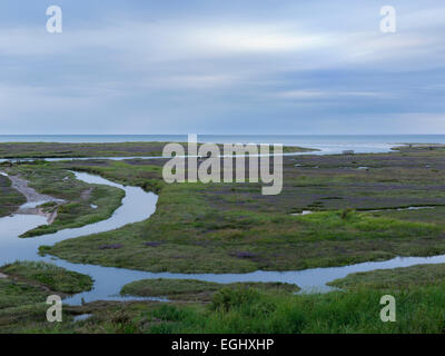 The tide coming in over the Saltmarshes at Stiffkey, North Norfolk, England - Stock Photo