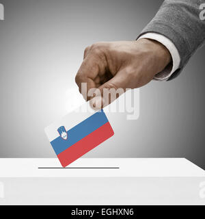 Black male holding flag. Voting concept - Slovenia - Stock Photo