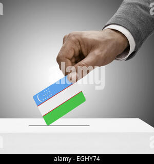 Black male holding flag. Voting concept - Uzbekistan - Stock Photo