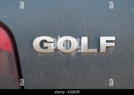 VW Golf logo on the back of a car - Stock Photo