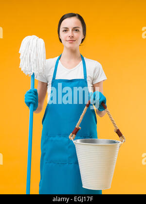 Girl Holding Bucket Of Cleaning Supplies Stock Photo