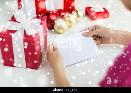 close up of woman with letter and presents - Stock Photo