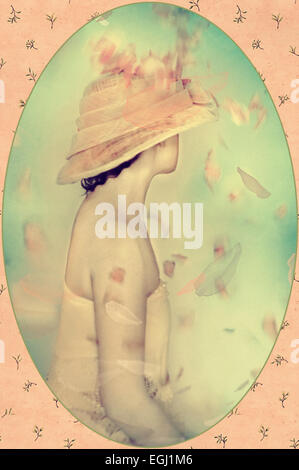 beautiful woman in fancy hat - Stock Photo
