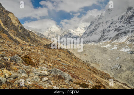 Picturesque view of mountains rising above a valley in Nepal - Stock Photo