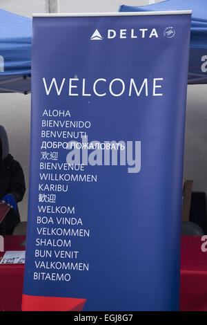 the word Welcome in many languages  promoting all the different countries Delta Airlines flies to. Booth during - Stock Photo