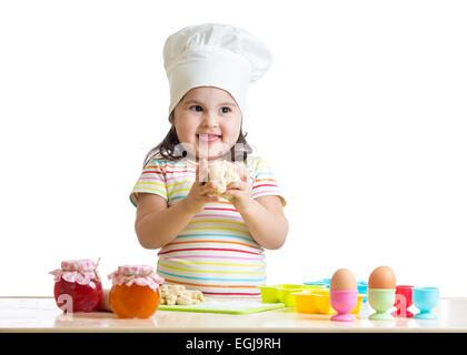 little girl kneading dough - Stock Photo