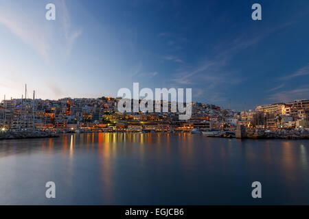 Typical colorful evening scenery in the Mikrolimano marina in Athens in the afternoon with clouds over the city - Stock Photo