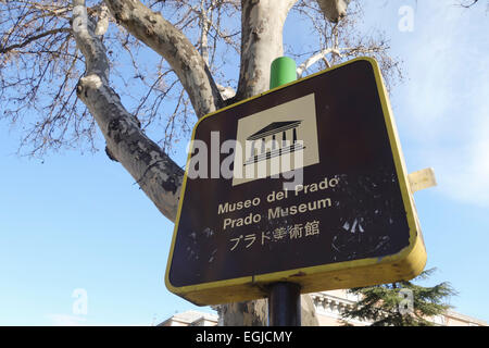 Sign indicating direction to Prado Museum, in English, Japanese and spanish, Madrid, Spain. - Stock Photo
