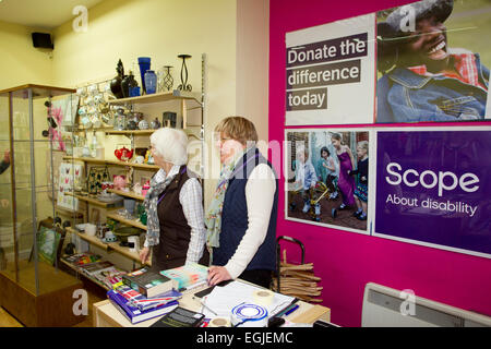 Scope shop & staff is a UK disability charity working with disabled people and their families - Stock Photo