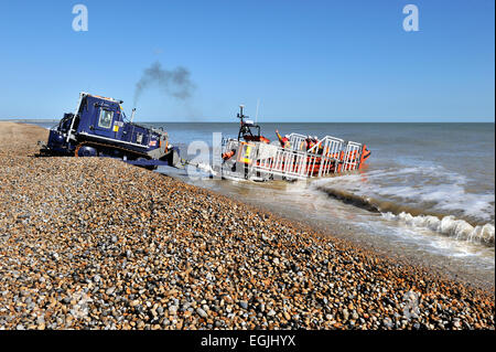 tractor retrieving lifeboat from the sea - Stock Photo