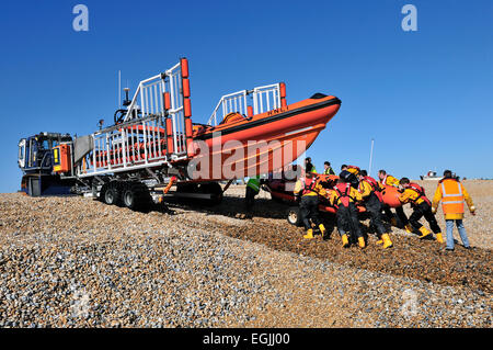 retrieving lifeboat from the sea - Stock Photo