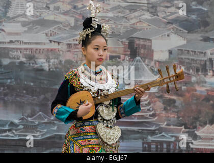 Dong woman playing a pipa, Zhaoxing Dong village, Guizhou Province, China - Stock Photo