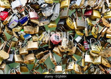 Padlocks left by lovers on the Pont des Arts, Paris, France. - Stock Photo