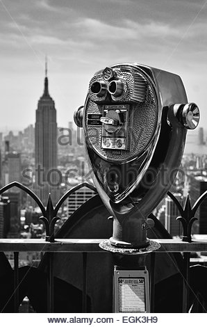 Coin operated binoculars with Empire State Building in background, New York, New York State, USA - Stock Photo