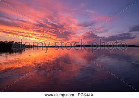 Idyllic sunset over lake - Stock Photo