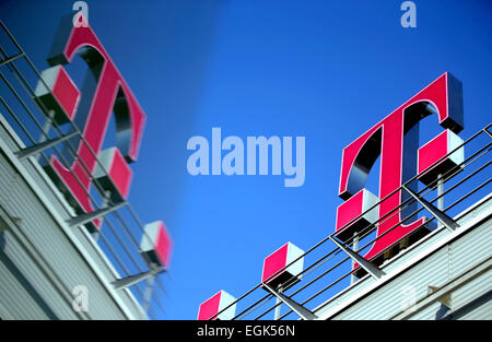 The Deutsche Telekom logo on the roof of their headquarters in Bonn on 26 February 2015, when the company releases - Stock Photo