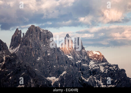 Cloudy sunset at Passo Rolle, Dolomites Alps, Italy - Stock Photo