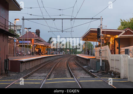 Commuters Waiting for a Train at Yarraville Station - Stock Photo
