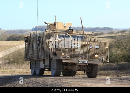 British Army Mastiff patrol vehicle driving on rough terrain - Stock Photo