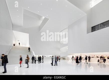 Szczecin Philharmonic Hall, Szczecin, Poland. Architect: Studio Barozzi Veiga, 2014. Overall view of grand foyer. - Stock Photo