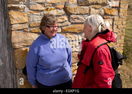 South Atlantic, Falklands, New Island, Charlene Rowland talking to cruise ship passenger - Stock Photo